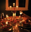 candlelight-dinner-table-glass-of-wine-1368707